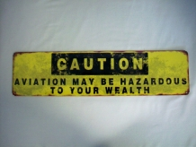 Hazard to Wealth Sign